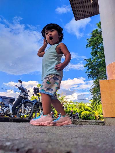Full length of cute girl against sky