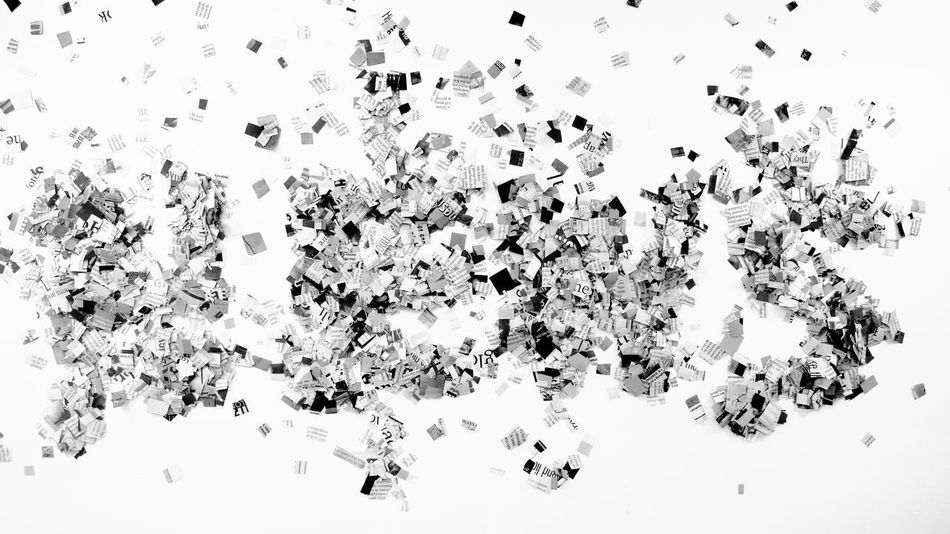 the news with newspaper cuttings Messy Random Text Word Background Backgrounds Close-up Conceptual Confetti Cuttings High Angle View Large Group Of Objects Magazine Monochrome News Newspaper No People Pattern Printed Media Studio Shot White Background White Color Words