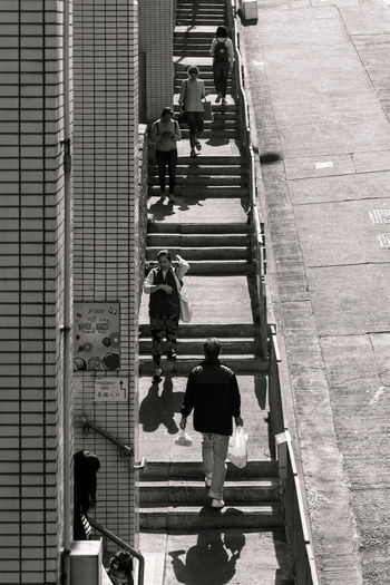 The Great Outdoors - 2018 EyeEm Awards Adult Architecture Building Exterior Built Structure City City Life Day Full Length Group Of People High Angle View Lifestyles Men Outdoors People Real People Rear View Staircase Steps And Staircases Walking Women The Street Photographer - 2018 EyeEm Awards