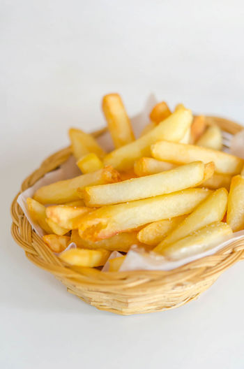 Basket Close-up Day Deep Fried  Fast Food Food Food And Drink French Fries Freshness Fried No People Potato Chip Prepared Potato Ready-to-eat Studio Shot Unhealthy Eating White Background