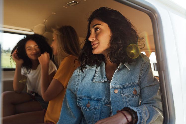 Portrait of happy woman sitting in car