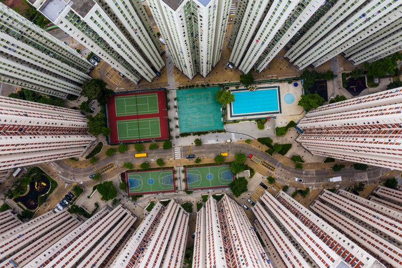 Top view of Hong Kong city district Hong Kong Top View Residential  Skyscraper Kowloon Bay District Apartment Public House Real Estate Tall Infrastructure Business Financial Building ASIA Urban Office Cityscape Architecture Downtown Metropolis Company Aerial Fly Drone  Over Above Down Top Down Bird Eye Hk Hong Kong City