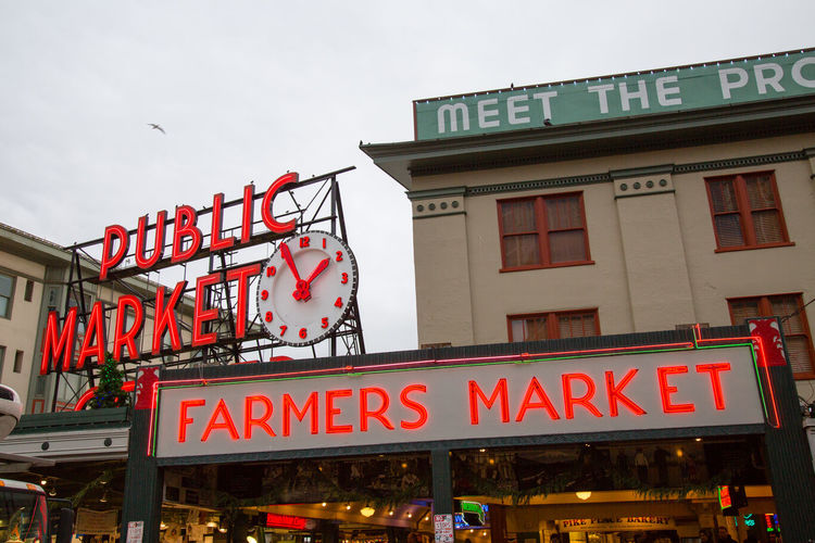 Pike Place public market sign in Seattle, Washington. Architecture Building Exterior Day Farmers Market Fish Market Market Neon Neon Lights Neon Sign Outdoors Pike Place Pike Place Market Public Market Seattle Sign Signboard Signs Store Text Tourism Tourist Attraction  Travel Travel Destinations Traveling Washington