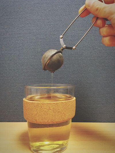 Cropped image of person making tea
