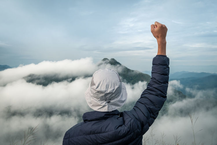 Sky One Person Cloud - Sky Real People Mountain Rear View Nature Lifestyles Leisure Activity Beauty In Nature Day Scenics - Nature Tranquility Men Fog Outdoors Non-urban Scene Adult Tranquil Scene Human Arm Arms Raised Warm Clothing Portrait Successful