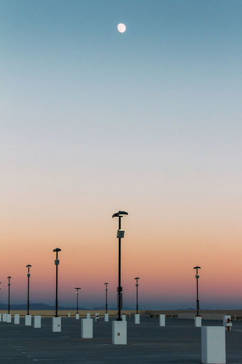 Architecture Beauty In Nature Empty Spaces Evening Las Vegas Lights Minimal Moon No People Order Outdoors Parking Lot Sky Sky Gradient Sunset Urban Structure Dramatic Sky Tranquil Scene Scenics Vertical Alignment