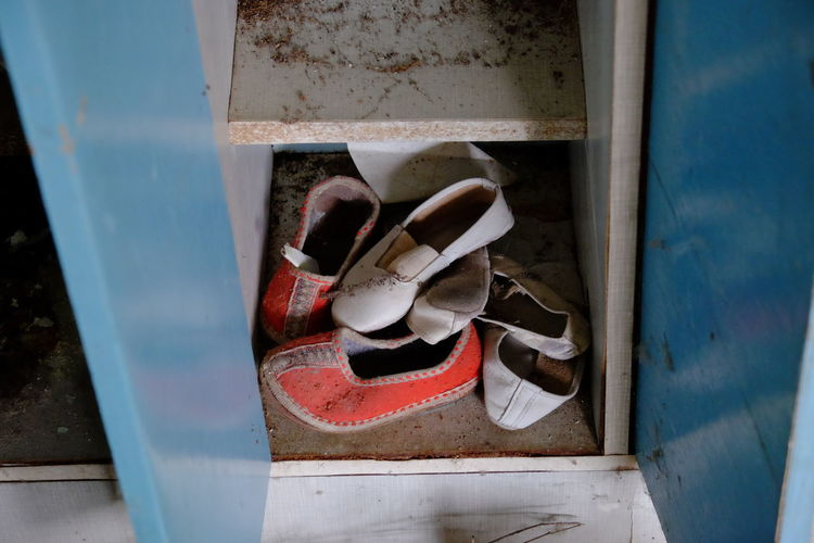 High angle view of abandoned shoes