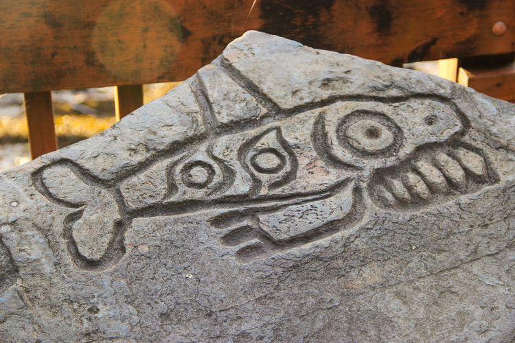 acient rock carving Ancient Art Is Everywhere Carvings In Stone Indian Culture  Rock Rock Formation Sign Tribal Alaska Ancient Civilization Carving Carving - Craft Product Close-up Day Fish History Marking No People Outdoors Pattern Rock Carving Rockcarving