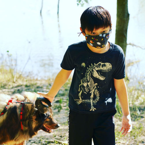 Rear view of boy with dog