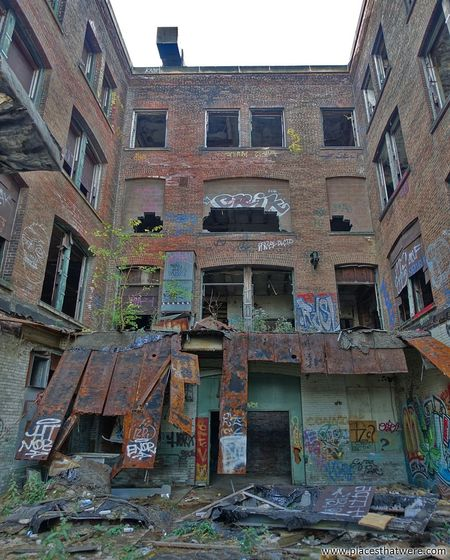 In the courtyard. http://www.placesthatwere.com/2017/12/abandoned-warner-and-swasey-company.html Abandoned Factory Windows Abandonedplaces Abandonedbuilding Urbex Urbanexploration Decay Creepy Eerie Abandoned Places Ruins Abandoned Buildings Abandoned & Derelict Urban Exploration Urban Decay Industry Industrial Decay Rust Belt Cleveland Ohio Architecture Graffiti Multi Colored Building Exterior Built Structure Street Art Low Angle View