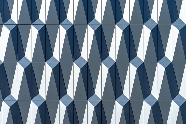 Futuristic Arts Culture And Entertainment Abstract Technology Business Business Finance And Industry Metal Aluminum Pattern Backgrounds Full Frame No People Repetition Design White Color Built Structure Architecture Shape Indoors  Wall - Building Feature Geometric Shape Day Close-up Textured  Blue In A Row Sunlight Architecture And Art