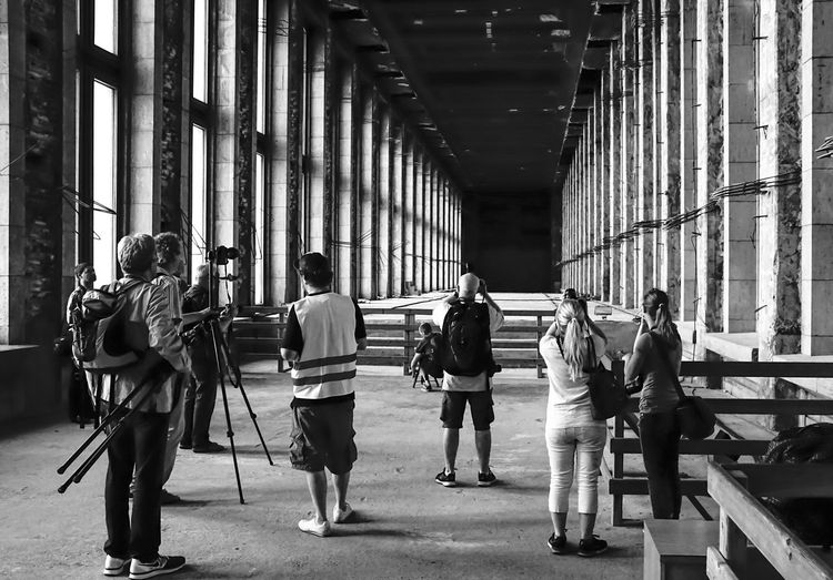 shooters in action - Foto Tour Flughafen Tempelhof Architectural Column B&w B&w Photography Black And White Blc Casual Clothing City City Life Day Flughafen Tempelhof  Fotograf Fotografen Fototour Friendship Full Length Leisure Activity Lifestyles Men Person Photograph Photographer Rear View The Way Forward Togetherness Walking