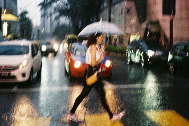 Blurred motion of cars on city street during rainy season