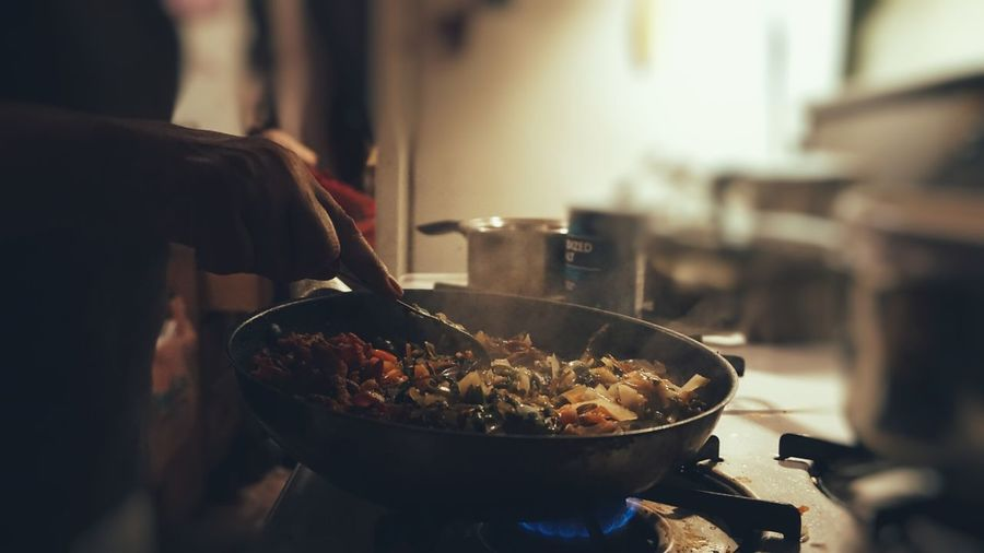 Midsection Of Woman Making Food In Kitchen