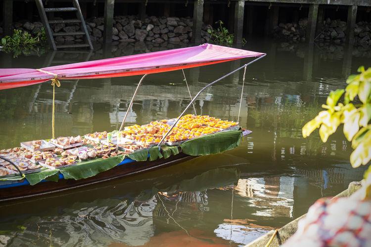 Lotus floating on water in lake
