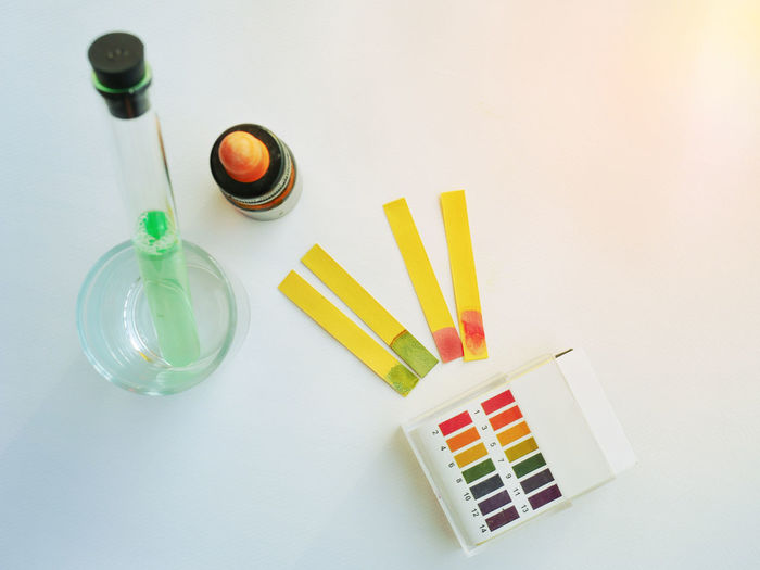 Acid Base Indicator Litmus Litmus Paper Choice Close-up Container Copy Space Droper Education Glass Lab Laboratory Multi Colored PH Paper Test Ph Solution Table Test Test Tube Water White Background