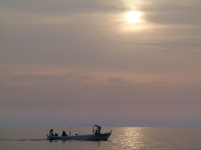 Sky Nautical Vessel Water Sea Transportation Sunset Mode Of Transportation Beauty In Nature Scenics - Nature Horizon Over Water Horizon Tranquil Scene Cloud - Sky Tranquility Waterfront Nature Sun Silhouette Idyllic Outdoors
