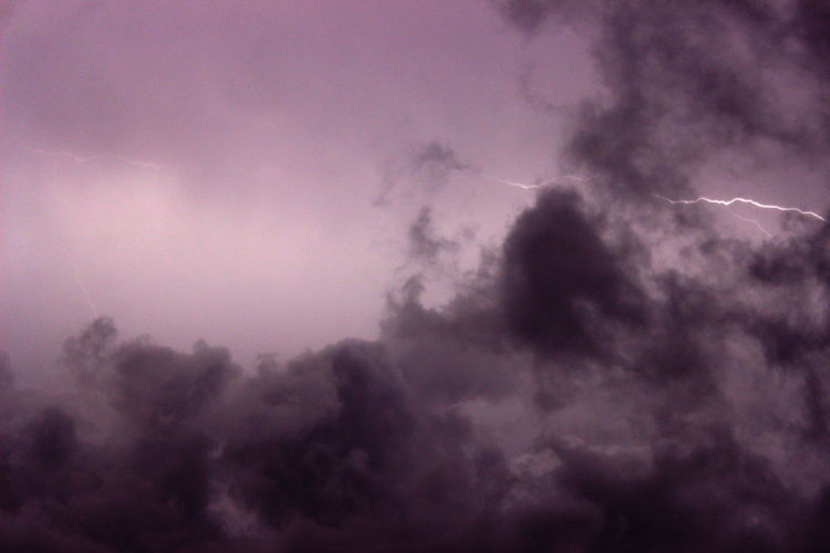 Low angle view of vapor trails in sky