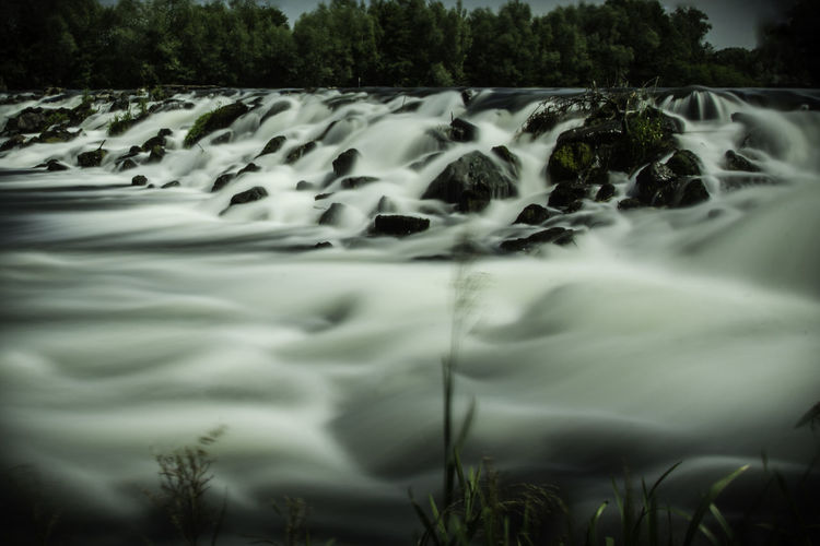 Beauty In Nature Blurred Motion Close-up Day Flowing Water Long Exposure Motion Nature No People Outdoors Power In Nature Rippled River Running Water Scenics Tranquility Tree Water Waterfall Waterfront