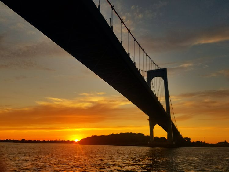 A wonderful sunset with no humidity! Photo taken below the White Stone Bridge, with Ferry Point Park, Bronx in the distance. (7/6/2018) New York EyeEm Selects Water Sunset Steel Sea City Bridge - Man Made Structure Silhouette Dusk Sky Suspension Bridge Cable-stayed Bridge Romantic Sky Bay Of Water
