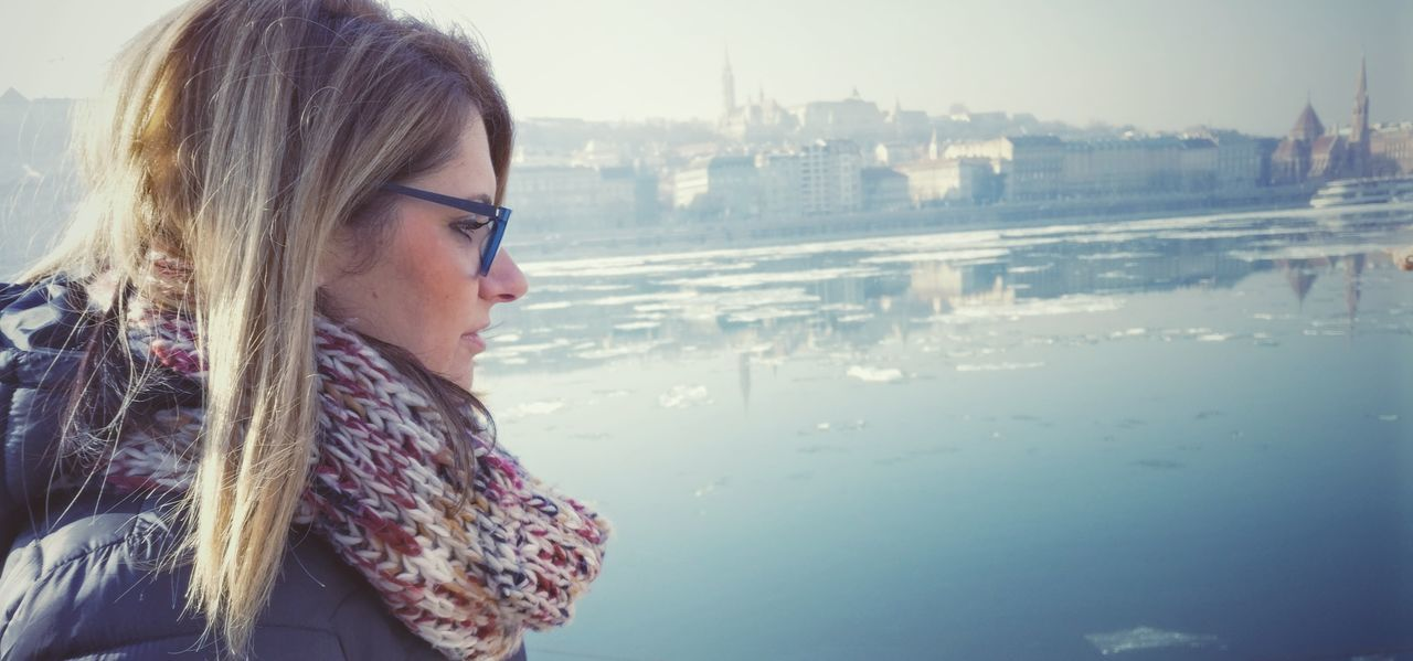 Side View Of Woman Wearing Muffler By River