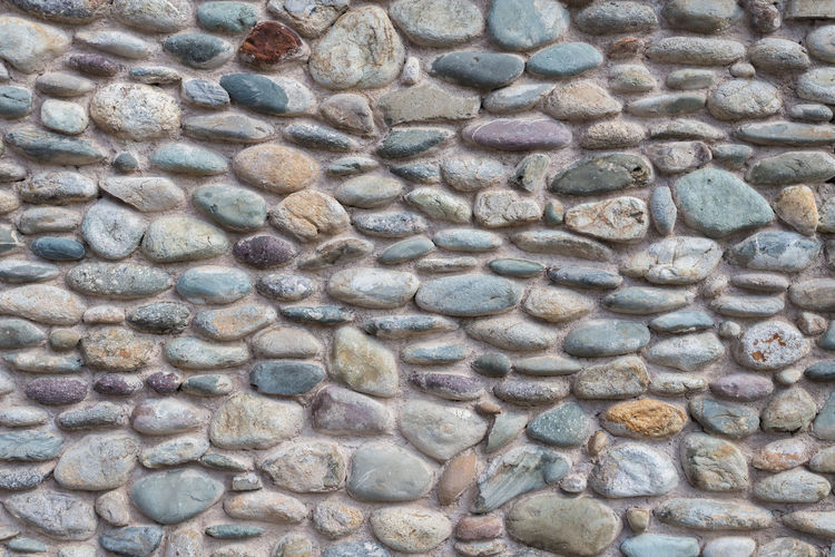 Abstract Architecture Art Background Blue Building Closeup Color Colored Construction Decorated Design Detail Flint Gravel Gray Grey Light Material Nobody Old Pattern Pebble Purple Retro Rock Round Smooth Solid Stone Structure Surface Texture Textured  Variegated Vintage Wall Wallpaper White