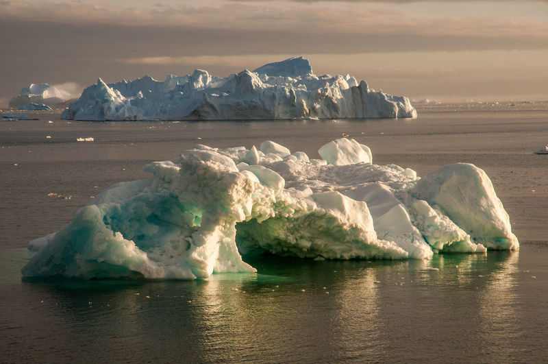 Greenland Arctic Beauty In Nature Cold Temperature Day Floating On Water Frozen Glacial Glacier Ice Iceberg Iceberg - Ice Formation Melting Mountain Nature No People Outdoors Scenics Sea Sky Tranquil Scene Tranquility Water Waterfront