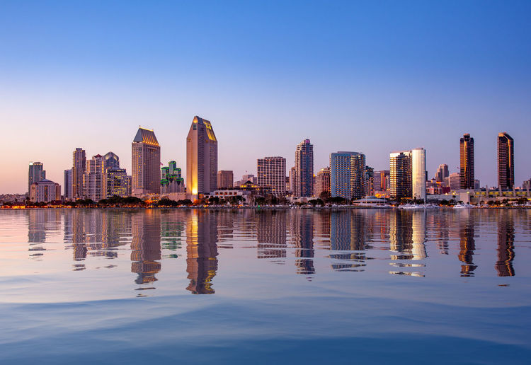 City skyline of San Diego with an artificial reflection added to the water in the lake to enhance the cityscape California City Cityscape Reflection San Diego Skyline Travel Architecture Building Building Exterior Coronado Dusk Financial District  No People Reflection Skyscraper Sunset Travel Destinations Water Waterfront