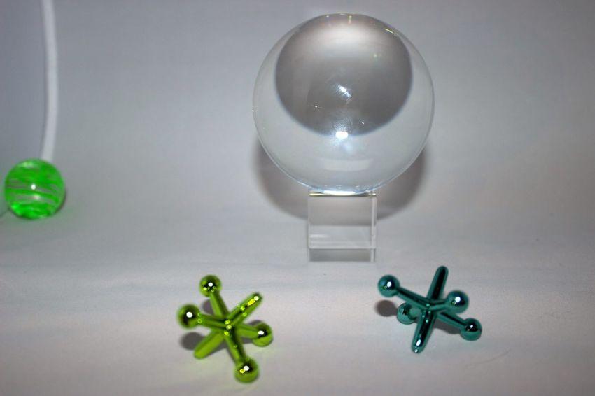 Jacks and Ball with Crystal Ball Ball Close-up Crystal Ball Day Green Green Ball Green Color High Angle View Indoors  Jacks Jacks And Ball No People