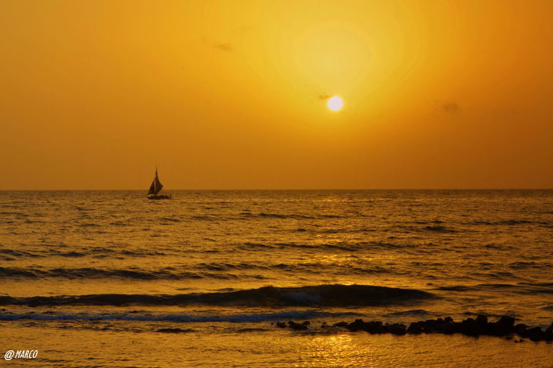 #love #haiti #sunrise #reflection Beach Beauty In Nature Day Horizon Over Water Nature Nautical Vessel No People Outdoors Sailboat Sailing Scenics Sea Silhouette Sky Sun Sunset Tranquil Scene Tranquility Travel Destinations Water Wave Yacht Yellow First Eyeem Photo