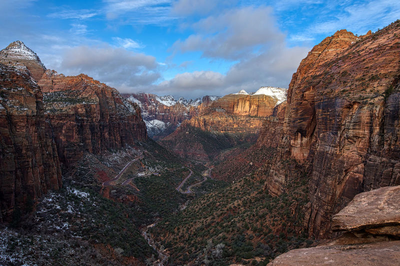 Sunrise in Pine Canyon from Canyon Overlook in Zion National Park Rock Rock Formation Rock - Object Solid Sky Cloud - Sky Geology Scenics - Nature Mountain Beauty In Nature Non-urban Scene Nature Tranquil Scene Tranquility Environment Physical Geography Travel Destinations Remote Day Landscape Formation No People Mountain Range Outdoors Eroded Pine Creek Canyon Pine Creek Gorge Morning Morning Light Blue Sky Zion National Park USA Canyon Overlook