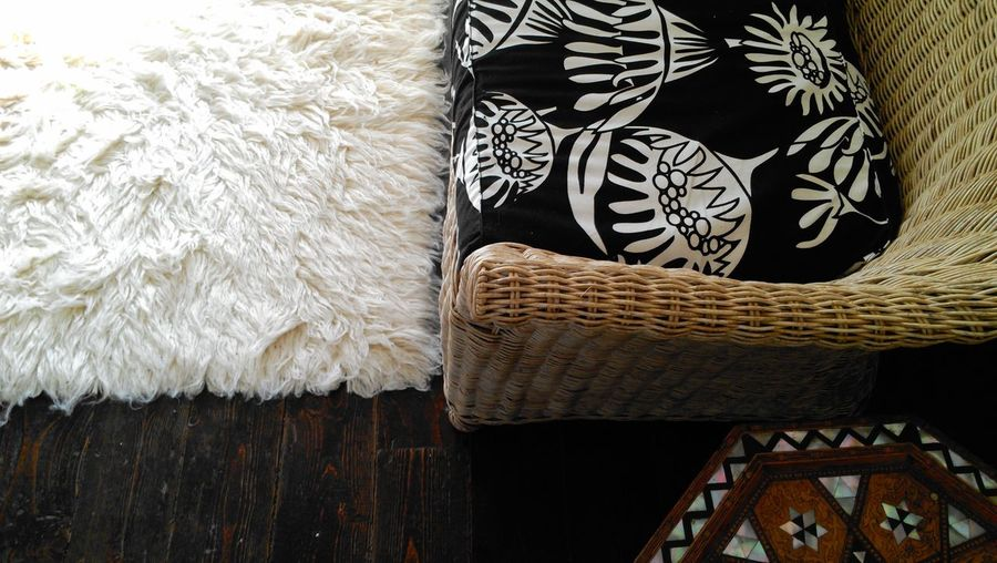 Interior Views Interior Style Wooden Floor Sofa Wicker Marquetry Mother Of Pearl Tabletop Faux Sheepskin Rug