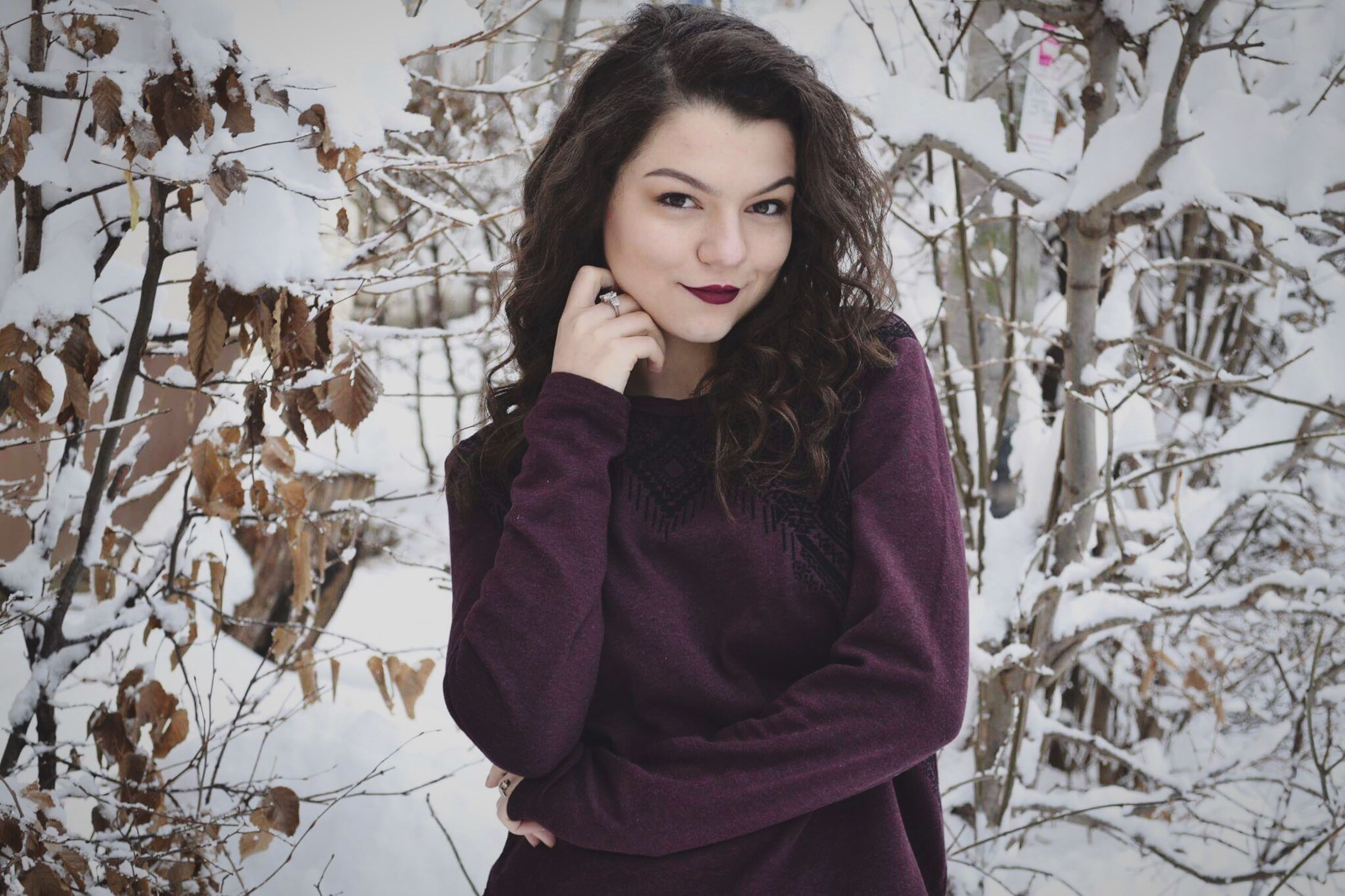 winter, portrait, looking at camera, cold temperature, snow, tree, long hair, front view, one person, young adult, nature, beauty, warm clothing, beautiful people, beautiful woman, people, confidence, one young woman only, adults only, adult, one woman only, young women, outdoors, smiling, only women, human body part, day
