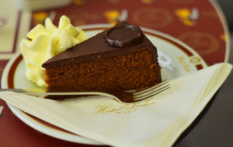 slice of sinfully deliciousness from the oldest establishment in Vienna. Choco Addiction Chocolate Cake Cream Dessert Hotel Sacher, Vienna Indulgence Pastry Sinfully Delicious Temptation
