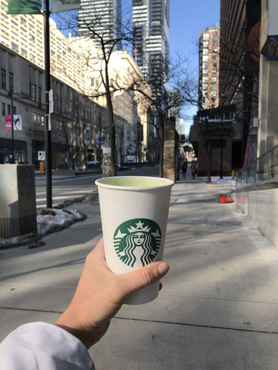 Matcha latte Building Exterior Disposable Cup Building Sidewalk Finger Refreshment Personal Perspective Human Body Part Drink Hand Holding Architecture Starbucks Matcha Latte Toronto Canada