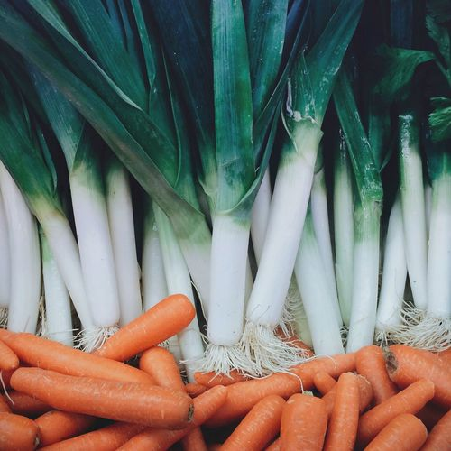 Close-up of carrots and leeks in market