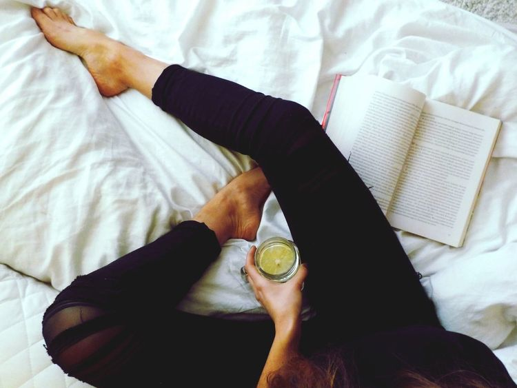 December Taking Photos Lemon Black Pants Bed Book Relaxing Reading Healthy Lifestyle EyeEm Best Shots Legs One Person Pattern White Pillow