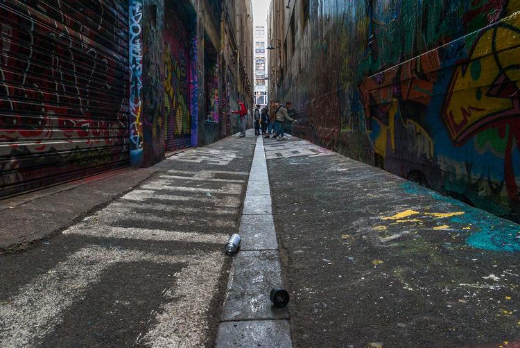 People on sidewalk in city