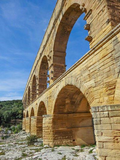Oct 2012 - Pont du Gard 1st Century Ancient Ancient Civilization Arch Arch Bridge Arched Architecture Built Structure Cloud - Sky Day History Low Angle View Nature No People Old Old Ruin Outdoors Roman Aqueduct Ruined Sky Sunlight The Past Tourism Travel Travel Destinations