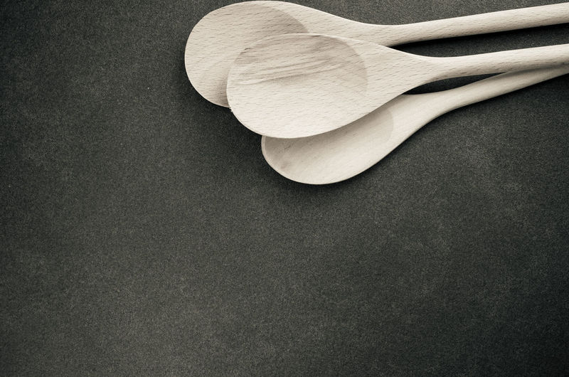 High angle view of wooden spoons on table