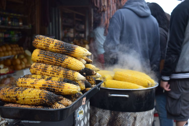 Close-up of roasted corns at food stall