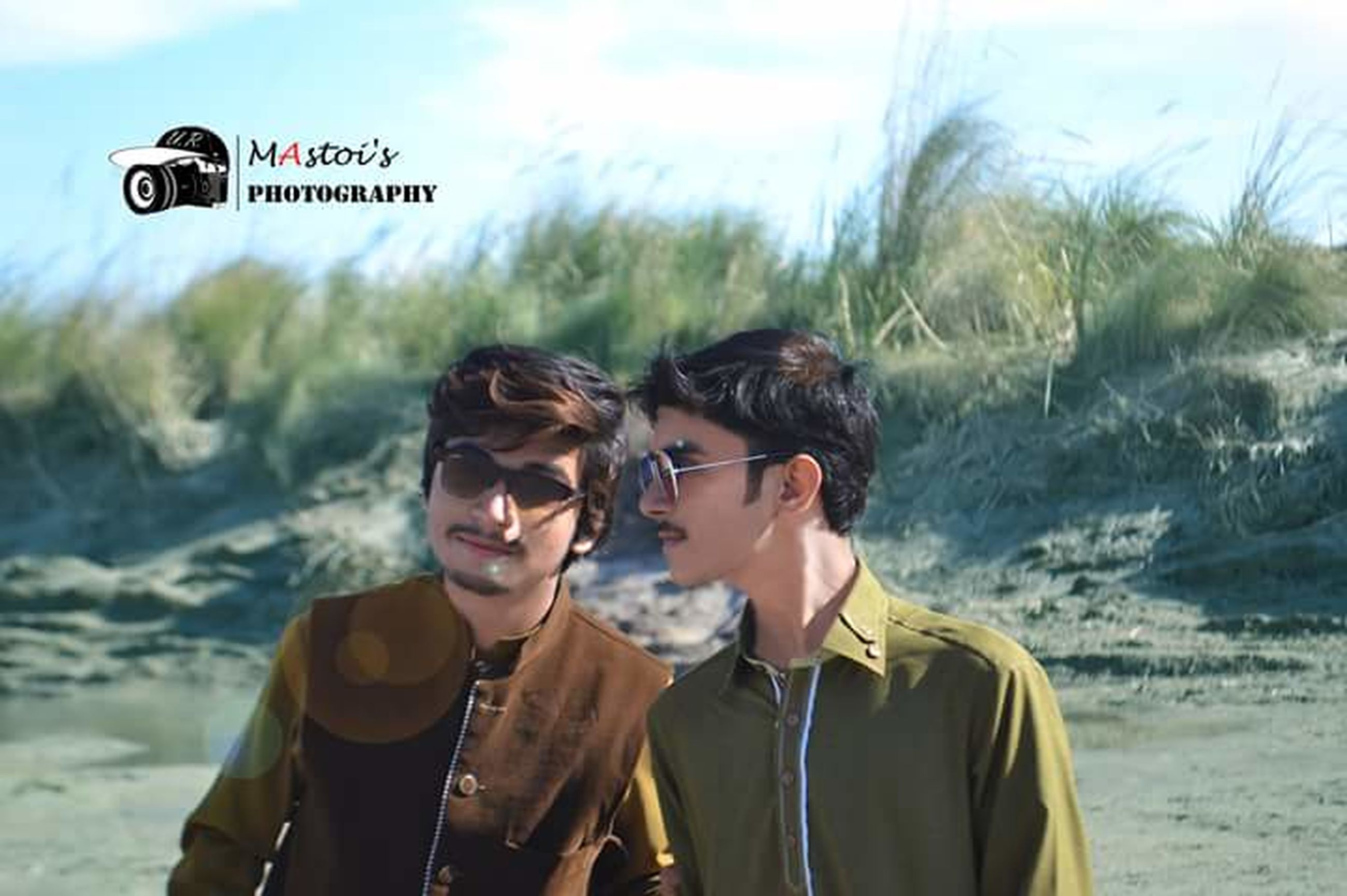 two people, young adult, young men, communication, togetherness, heterosexual couple, wireless technology, smiling, young women, young couple, lifestyles, men, friendship, women, couple - relationship, portable information device, happiness, outdoors, real people, adult, selfie, vacations, people, bonding, water, cheerful, adults only, portrait, day, sky