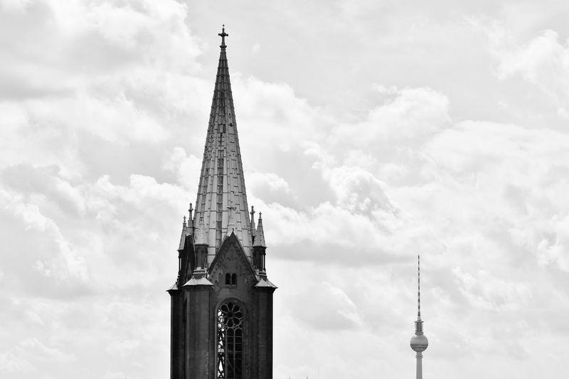 St Mary Church And Fernsehturm Against Cloudy Sky