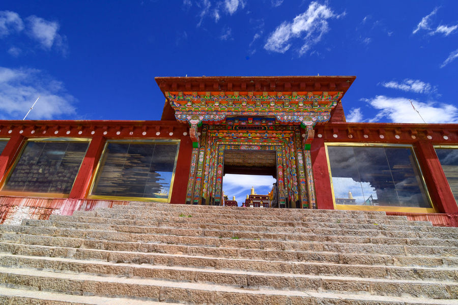 tibet temple Tibet Travel Tibetan Buddhism Ancient Civilization Architecture Building Exterior Built Structure Cloud - Sky Day Low Angle View Outdoors Real People Sky Steps Steps And Staircases Temple Tibet Tibetan  Tibetan Culture Tibetan Prayer Flags Tourism Travel Destinations