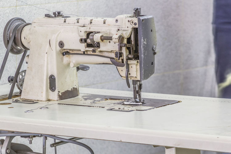 Close-up of machine part on table