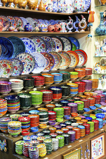 Abundance Arrangement Ceramics Choice Clay Collection Colorful Display For Sale Grand Bazaar In A Row Large Group Of Objects Market Market Stall Multi Colored No People Order Retail  Sale Shelf Shop Small Business Still Life Store Variation