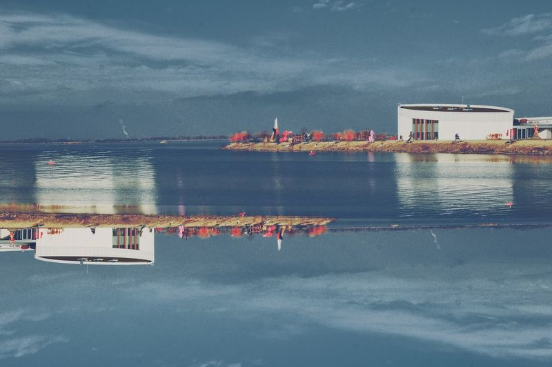 River River Danube Double Exposure Landscape Blue Minimal Architecture Architectural Feature Urban Urbanphotography Point Of View Water Beach Nautical Vessel Sky Horizon Over Water Residential Structure Building Calm Residential District Countryside My Best Photo