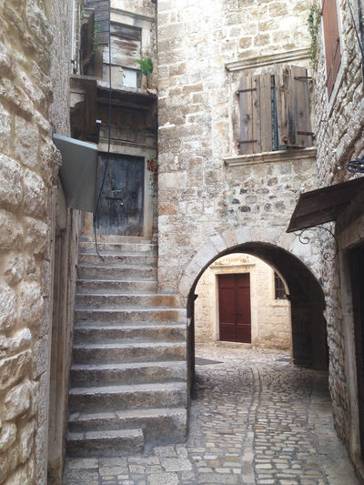 Stone city Arch Architecture Building Exterior Croatia Entrance Exterior Façade House Medieval Architecture Old Old Buildings Old Town Passage Stairs Stairs_collection Steps Stone Stone - Object Stone Material Stone Wall Street Streetphotography Town Trogir Windows