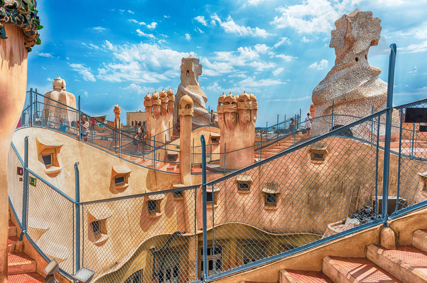 BARCELONA - AUGUST 9: The scenic architecture on the rooftop of Casa Mila, aka La Pedrera, designed by Antoni Gaudi and iconic landmark in Barcelona, Catalonia, Spain, on August 9, 2017 Built Structure Architecture Sky Building Exterior Cloud - Sky Art And Craft No People History Building The Past Day Representation Nature Travel Destinations Travel Sculpture Craft Creativity Human Representation City Outdoors