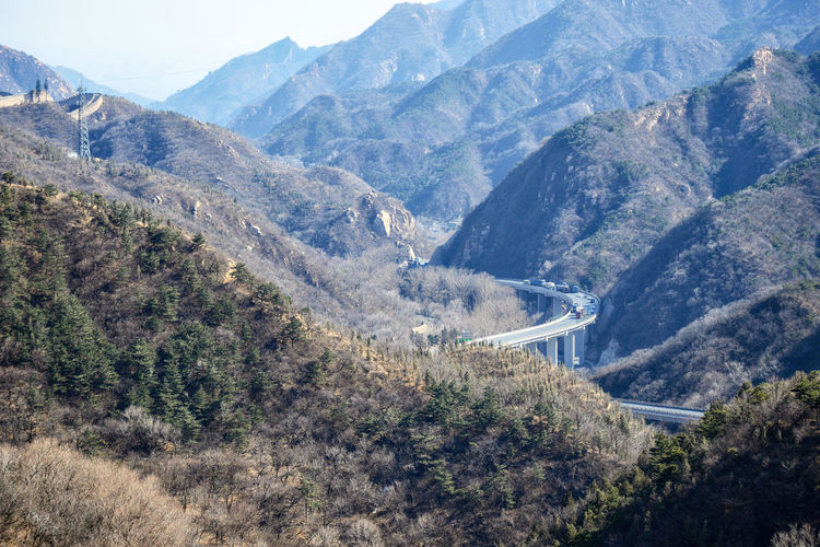 Highway between the mountains near the Great Wall of China in the mountains near Bejing. ASIA Ancient Badaling Beijing Panorama Border Brick China Culture Forest Hill History Landscape Miracle Mountain Tourism Unesco Unesco World Heritage Wonder